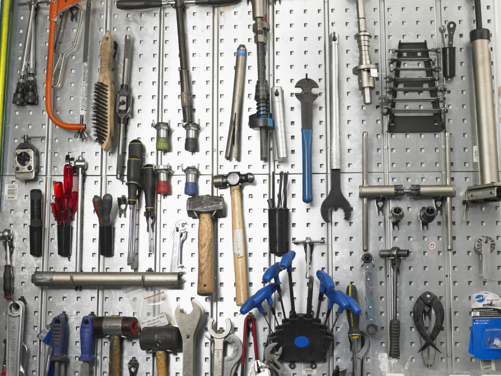 Tools hanging from pegboard